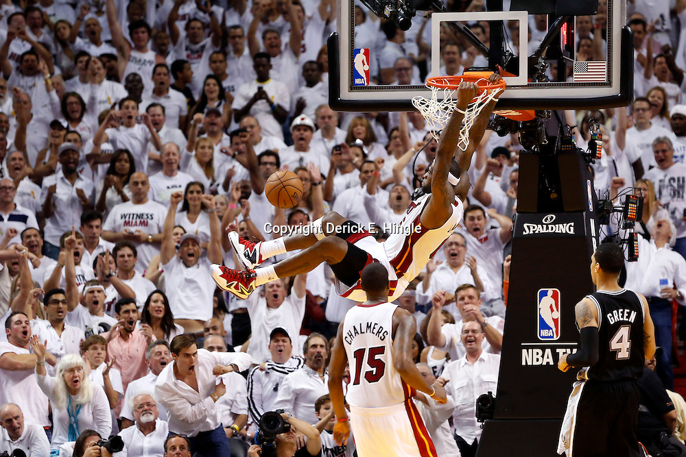 Jun 9, 2013; Miami, FL, USA;  Miami Heat small forward LeBron James (6) dunks against the San Antonio Spurs during the fourth quarter of game two of the 2013 NBA Finals at the American Airlines Arena. Mandatory Credit: Derick E. Hingle-USA TODAY Sports