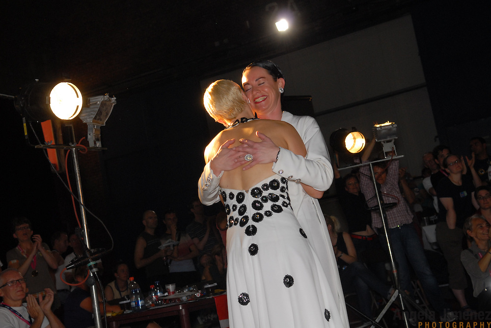 Petra Zimmermann, left, and Caroline Privou, rear, both of Cologne, Germany, react to the announcement that they have won the championship in the adult women's standard A division of the same-sex ballroom dancing competition during the 2007 Eurogames at the Waagnatie hangar in Antwerp, Belgium on July 14, 2007. ..Over 3,000 LGBT athletes competed in 11 sports, including same-sex dance, during the 11th annual European gay sporting event. Same-sex ballroom is a growing sports that has been happening in Europe for over two decades.