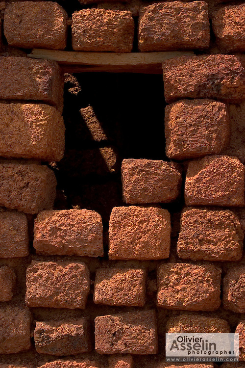 Window of a Sudanese-style mud-brick mosque in Bani, Northeastern Burkina Faso, West Africa.