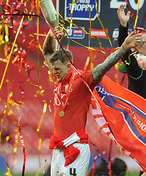 Bristol City's Aden Flint celebrates winning the Johnstone Paint Trophy - Photo mandatory by-line: Dougie Allward/JMP - Mobile: 07966 386802 - 22/03/2015 - SPORT - Football - London - Wembley Stadium - Bristol City v Walsall - Johnstone Paint Trophy Final