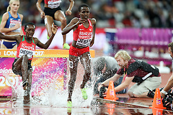 London, August 11 2017 . Celliphine Chepteek Chespol, Kenya, and Ruth Jebet, Bahrain, splash though the water in the women's 3000m steeplechase final on day eight of the IAAF London 2017 world Championships at the London Stadium. © Paul Davey.