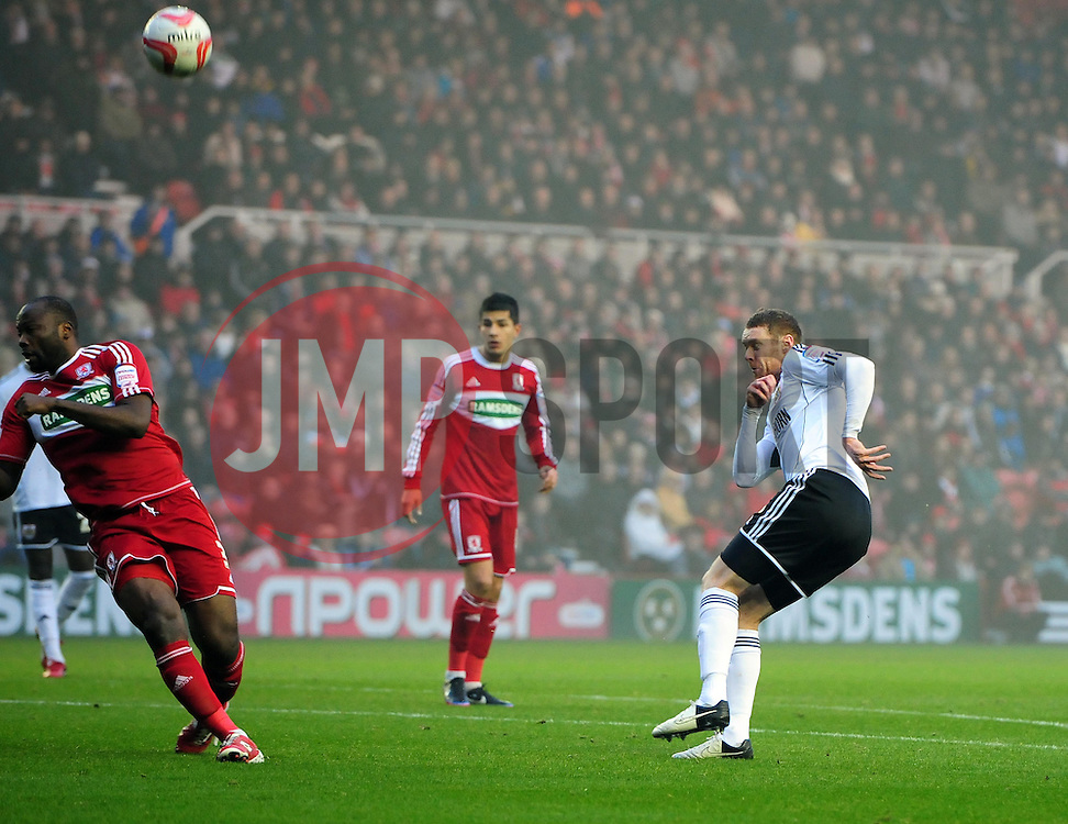 Bristol City's Stephen Pearson fires his shot against Middlesbrough's Andre Bikey - Photo mandatory by-line: Joe Meredith/JMP  - Tel: Mobile:07966 386802 24/11/2012 - Middlesbrough v Bristol City - SPORT - FOOTBALL - Championship -  Middlesbrough  - River Side Stadium