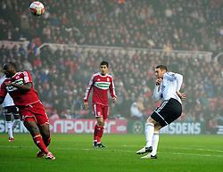 Bristol City's Stephen Pearson fires his shot against Middlesbrough's Andre Bikey - Photo mandatory by-line: Joe Meredith/JMP  - Tel: Mobile:07966 386802 24/11/2012 - Middlesbrough v Bristol City - SPORT - FOOTBALL - Championship -  Middlesbrough  - River Side Stadium