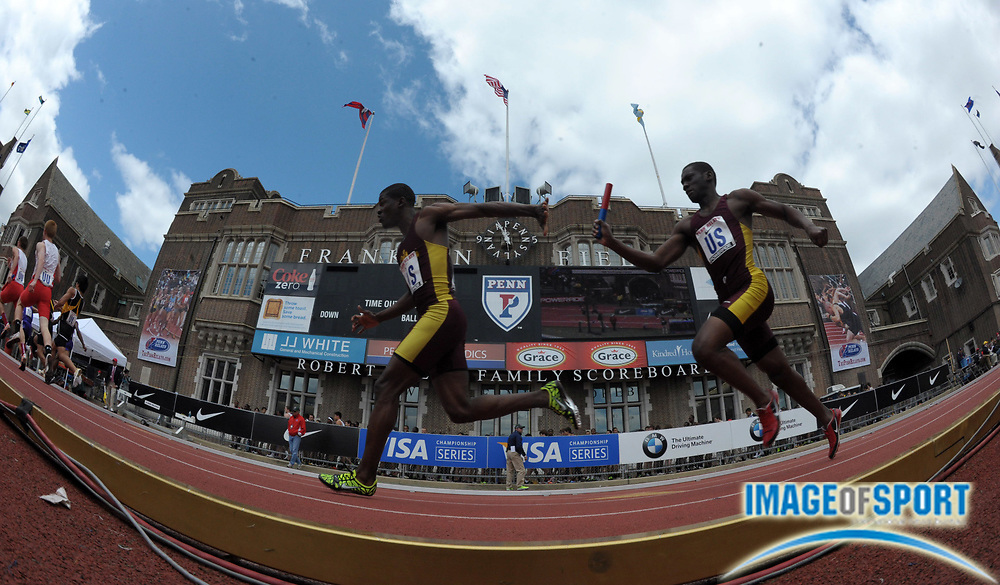 Apr 27, 2012; Philadelphia, PA, USA; General view of a handoff between Kervin Ocean (right) and Steven Gayle of Mount Vernon on the second leg of a boys large school 4 x 100m relay heat in  the 118th Penn Relays at Franklin Field.