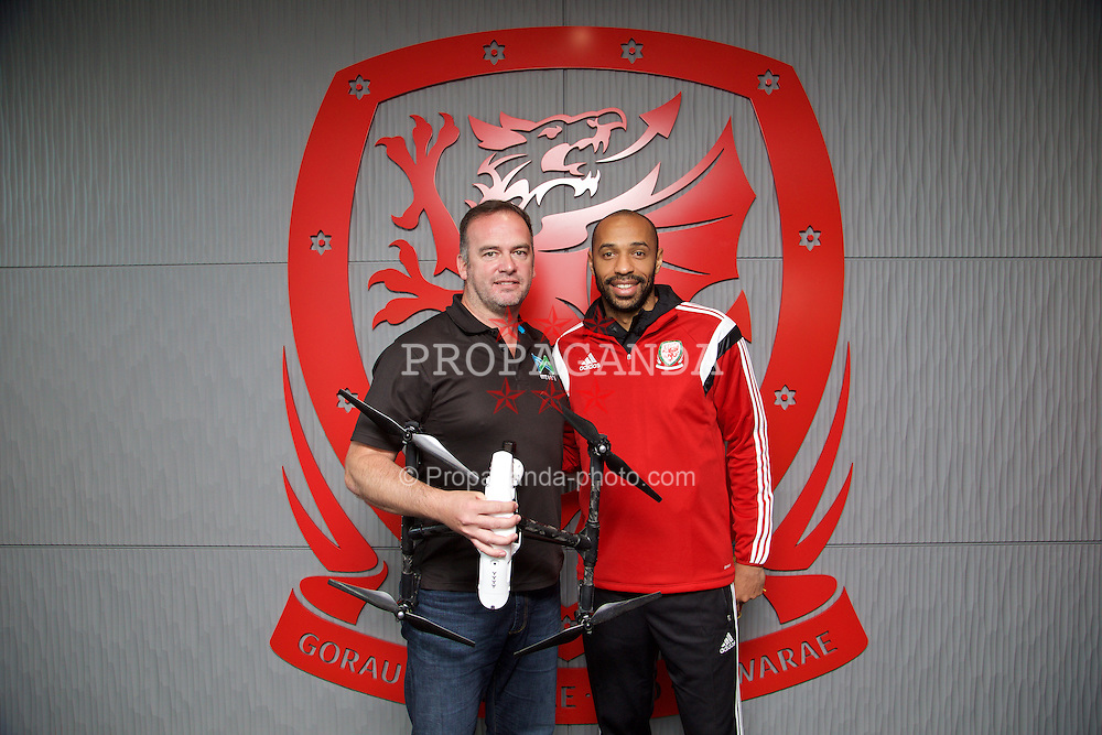 NEWPORT, WALES - Sunday, May 31, 2015: Thierry Henry with Mark Wynne of M7 Digital during the Football Association of Wales' National Coaches Conference 2015 at Dragon Park FAW National Development Centre. (Pic by David Rawcliffe/Propaganda)