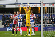 QPR goalkeeper Joe Lumley (13) holds arms up defending a Brentford corner during the EFL Sky Bet Championship match between Queens Park Rangers and Brentford at the Loftus Road Stadium, London, England on 10 November 2018.