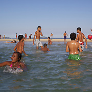 Local youngsters play in the water pools on Sao Conrado beach, Rio de Janeiro,  Brazil. 7th July 2010. Photo Tim Clayton..