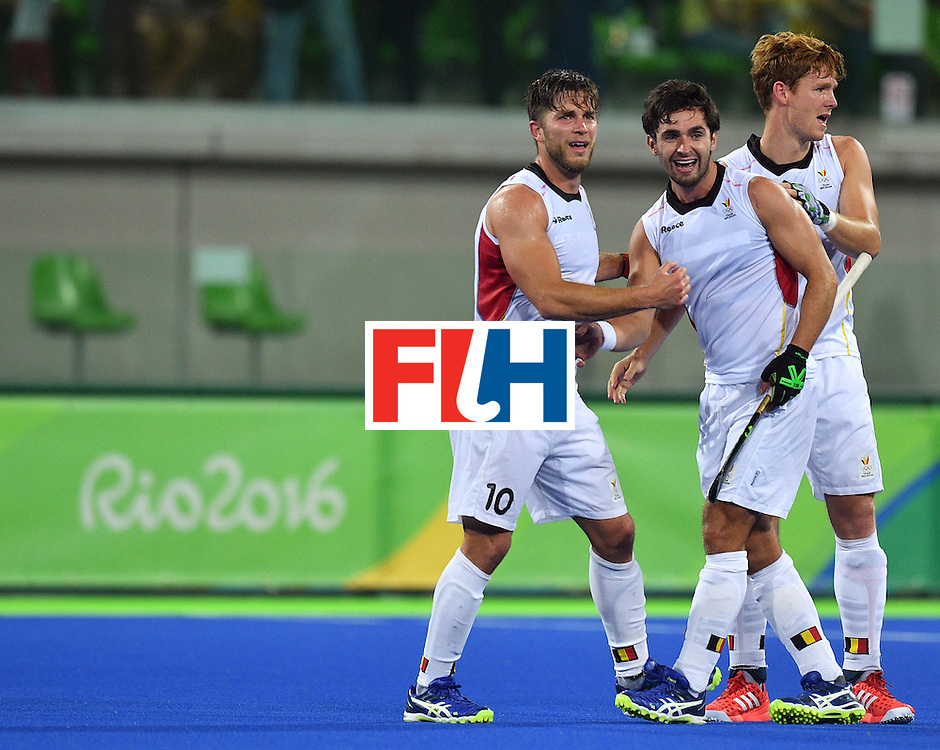 Belgium's Cedric Charlier (L), Belgium's Loick Luypaert (C) and Belgium's Gauthier Boccard celebrate after winning the men's semifinal field hockey Belgium vs Netherlands match of the Rio 2016 Olympics Games at the Olympic Hockey Centre in Rio de Janeiro on August 16, 2016.  / AFP / Carl DE SOUZA        (Photo credit should read CARL DE SOUZA/AFP/Getty Images)