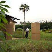 A voter exits a polling boot in a polling station in Kinama neighbourhood in Bujumbura, to vote in the country's parliamentary elections, on June 29, 2015.
