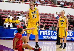 March 20, 2010; Stanford, CA, USA; Iowa Hawkeyes forward Kelly Krei (20) helps Rutgers Scarlet Knights guard Nikki Speed (11) during the first half in the first round of the 2010 NCAA womens basketball tournament at Maples Pavilion. Iowa defeated Rutgers 70-63.