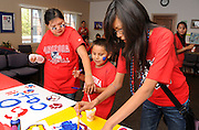 Ashley Scott, 16, (left), Denim Manygoats, 6, and Natasha Manygoats, 12, make posters in support of the football team during NASA Wildcat Family Pride Weekend before a game at the University of Arizona, Tucson, Arizona, USA.