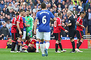 Referee Anthony Taylor talks to Wayne Rooney of Manchester United after booking Ander Herrera of Manchester United during the The FA Cup semi final match between Everton and Manchester United at Wembley Stadium, London, England on 23 April 2016. Photo by Phil Duncan.