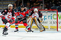 KELOWNA, BC - NOVEMBER 1:  Leif Mattson #28 of the Kelowna Rockets looks for the pass while checked by Cole Moberg #2 in front of the net of Jacob Herman #33 of the Prince George Cougars at Prospera Place on November 1, 2019 in Kelowna, Canada. (Photo by Marissa Baecker/Shoot the Breeze)