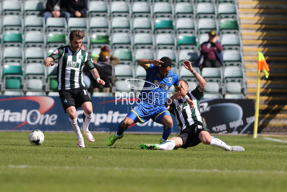 Plymouth Argyle defender Jordon Forster (28) tackles Andy Barcham midfielder for AFC Wimbledon (17) during the Sky Bet League 2 match between Plymouth Argyle and AFC Wimbledon at Home Park, Plymouth, England on 9 April 2016. Photo by Stuart Butcher.