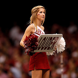 January 4, 2011; New Orleans, LA, USA;  A Arkansas Razorbacks cheerleader holds up a sign during the fourth quarter of the 2011 Sugar Bowl against the Ohio State Buckeyes at the Louisiana Superdome.Ohio State defeated Arkansas 31-26. Mandatory Credit: Derick E. Hingle