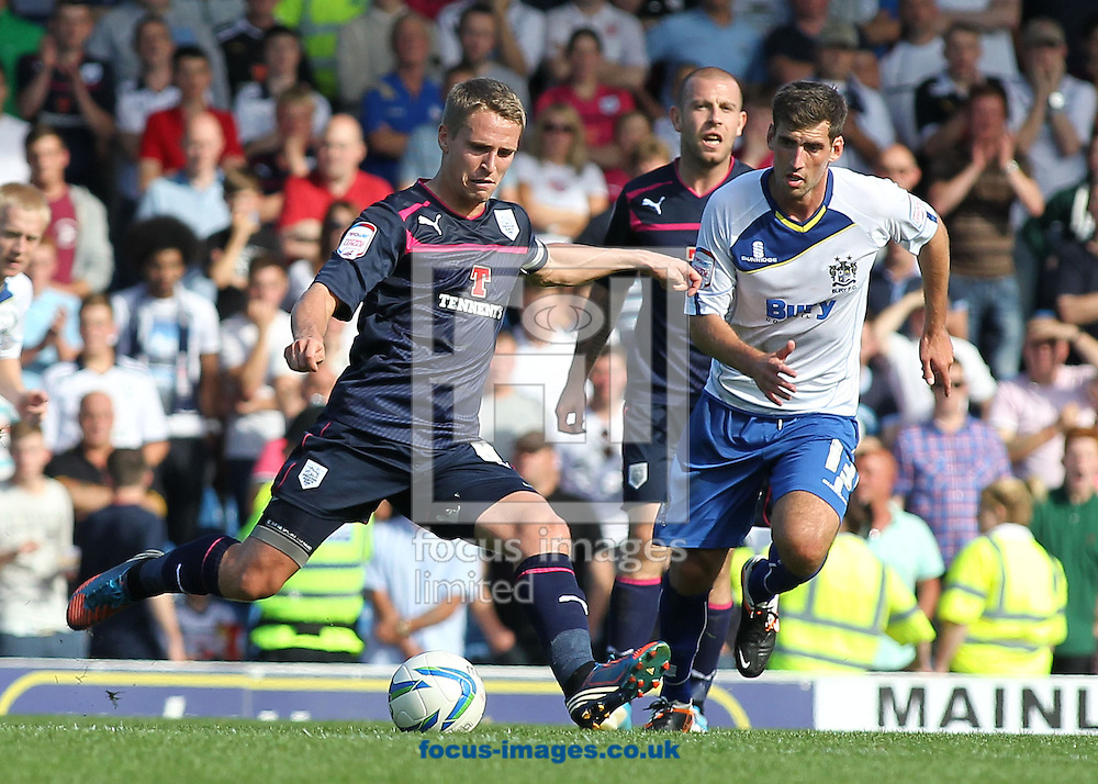 Picture by Michael Sedgwick/Focus Images Ltd +44 7900 363072.08/09/2012.Mark Carrington of Bury and Nicky Wroe of Preston North End in action during the npower League 1 match at Gigg Lane, Bury.
