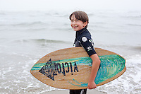 Nathan Vega prepares to skim board on the beach near Newport, Oregon.