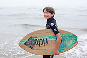 Nathan Vega prepares to skim board on the beach near Newport, Oregon.