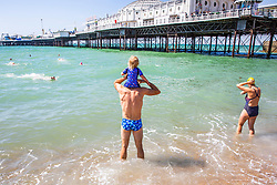 © Licensed to London News Pictures. 15/06/2019. Brighton, UK. Members of the Brighton Swimming Club go for a swim in the sea as mild and warmer weather is hitting the seaside resort. Photo credit: Hugo Michiels/LNP