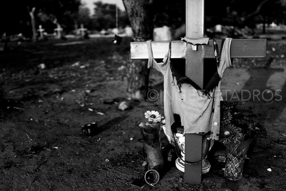 A ripped shirt on a cross... a grave in a cemetery. Broome,<br />