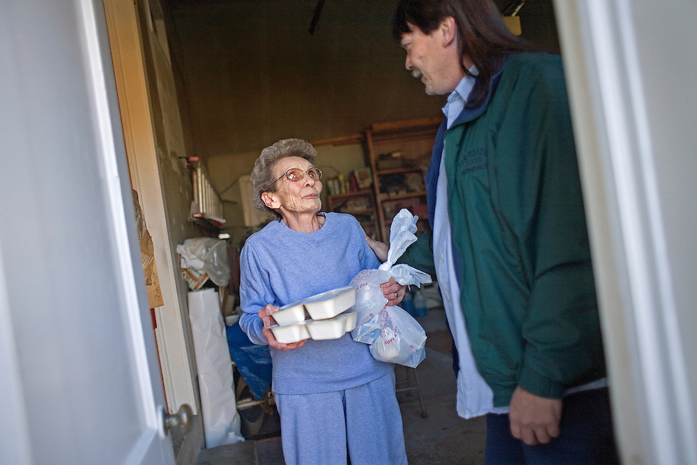 Garret County Community Action Non-Profit...Rocky Ford, Loch Lynn bus driver of 25 years, delivers meals to the elderly...Images of the Garrett County Community Action-Area Agency on Aging..Home Delivered Meals:.A nutritionally balanced meal is delivered to frail homebound elderly five days a week...Support Services:.Social, recreational, educational opportunities, trips, legal assistance are offered to older adults at Senior Centers and Eating Together Sites. A telephone reassurance service for homebound elderly is available as well as a cellular phone loaner program.