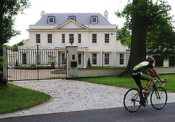A cyclist goes past the reportedly rented home near Potter's Bar, of singer and X-factor judge Tulisa Contostavlos Friday June 7, 2013. She has not been seen since, or the letter box emptied since she was released on bail for reportedly involvement in drugs on Tuesday june 4, 2013<br />