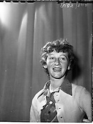 22/05/1959<br /> 05/22/1959<br /> 22 May 1959<br /> Gael Linn Singing Competition at the Dominican Convent, Dun Laoghaire. Image shows 15 year old Ursula Ní Brennan, 31 Sallynoggin Park, Dun Laoghaire, winner of 1st prize of £10 and a Radio Audition . A past pupil of Dominican Convent attending the Technical School Dun Laoghaire.