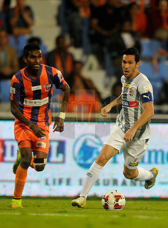 Luis Javier Garcia Sanz of Atletico de Kolkata and Israil Gurung of FC Pune City during match 44 of the Hero Indian Super League between FC Pune City and Atletico de Kolkata FC held at the Shree Shiv Chhatrapati Sports Complex Stadium, Pune, India on the 29th November 2014.<br /> <br /> Photo by:  Pal Pillai/ ISL/ SPORTZPICS