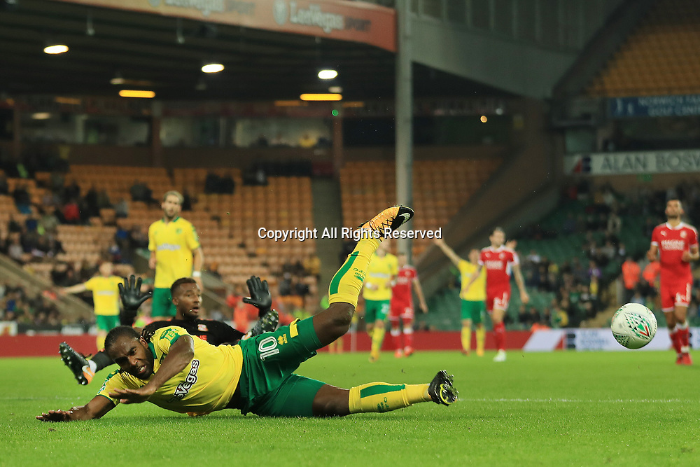 August 8th 2017, Carrow Road, Norwich, England; Carabao Cup First Round; Norwich City versus Swindon Town; Lawrence Vigouroux of Swindon Town brings down Cameron Jerome of Norwich City
