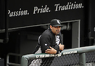 CHICAGO - MAY 21:  Manager Ozzie Guillen #13 of the Chicago White Sox looks on from the dugout during the game against the Los Angeles Dodgers on May 21, 2011 at U.S. Cellular Field in Chicago, Illinois.  The White Sox defeated the Dodgers 9-2.  (Photo by Ron Vesely)  Subject:   Ozzie Guillen