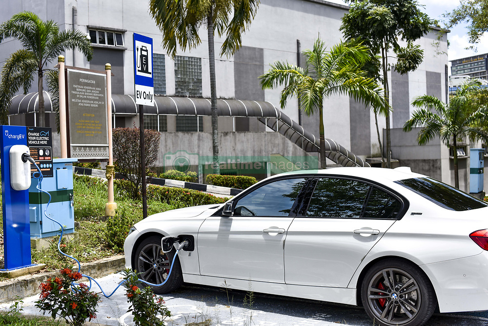April 3, 2017 - Kuala Lumpur, Malaysia - BMW 330e iPerformance Sport plug-in hybrid charging at University of Malaya on April 03 2017 in Kuala Lumpur, Malaysia. .Malaysian Green Technology Corporation, Ahmad Hadri Haris, said from 2016, 2017 alone, we are going to have 300 charging stations. The goal over the next five years is to have 25,000 public charging stations  (Credit Image: © Chris Jung/NurPhoto via ZUMA Press)