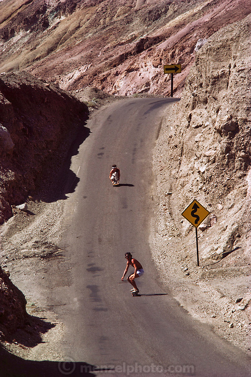 Death Valley. Skateboarding on road along Artist's Drive through Artist's Palette.