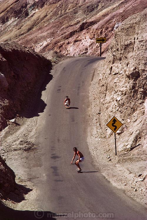 Death Valley. Skateboarding on road along Artist's Drive through Artist's Palette.