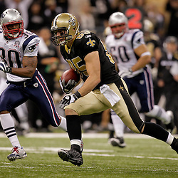 2009 November 30: New Orleans Saints tight end David Thomas (85) runs  away from New England Patriots safety Brandon McGowan (30) after a catch during a 38-17 win by the New Orleans Saints over the New England Patriots at the Louisiana Superdome in New Orleans, Louisiana.