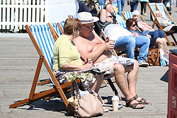 © Licensed to London News Pictures. 13/05/2015. Brighton, UK. Members of the public ton Brighton Pier as temperatures hit 16C down the South Coast, Today Tuesday May 13th 2015 Photo credit : Hugo Michiels/LNP