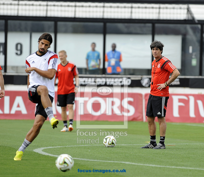 Germany manager Joachim Low keeps an eye on Sami Khedira during Germany training at Maracana Stadium, Rio de Janeiro<br /> Picture by Stefano Gnech/Focus Images Ltd +39 333 1641678<br /> 12/07/2014