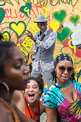 London, August 28 2017. An old man dances as the floats pass by on Day Two of the Notting Hill Carnival, Europe's biggest street party held over two days of the August bank holiday weekend, attracting over a million people. © Paul Davey.