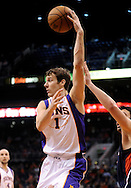 Mar. 1, 2013; Phoenix, AZ, USA; Phoenix Suns guard Goran Dragic (1) makes a pass against the Atlanta Hawks in the second half at US Airways Center. The Suns defeated the Hawks 92-87. Mandatory Credit: Jennifer Stewart-USA TODAY Sports