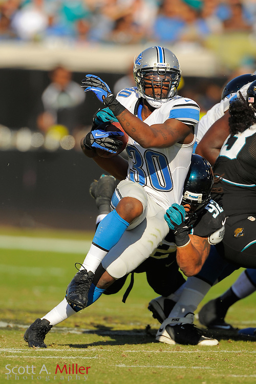 Detroit Lions running back Kevin Smith (30) runs up field during the Lions 31-14 win over the Jacksonville Jaguars at EverBank Field on November 4, 2012 in Jacksonville, Florida. ..©2012 Scott A. Miller..