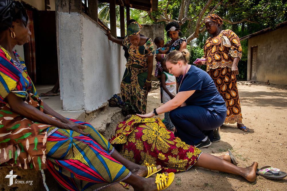 Lauren Awe, a nurse attending Beautiful Savior Lutheran Church, La Vista, Neb., tends to a patient on the fourth day of the LCMS Mercy Medical Team on Thursday, May 10, 2018, in the Yardu village outside Koidu, Sierra Leone, West Africa. LCMS Communications/Erik M. Lunsford