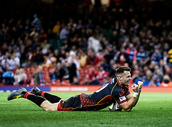 Josh Lewis of Dragons celebrates scoring his sides third try<br /> <br /> Photographer Simon King/Replay Images<br /> <br /> Guinness PRO14 Round 21 - Dragons v Scarlets - Saturday 27th April 2019 - Principality Stadium - Cardiff<br /> <br /> World Copyright © Replay Images . All rights reserved. info@replayimages.co.uk - http://replayimages.co.uk