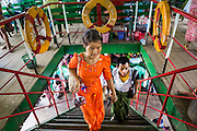 08 JUNE 2014 - YANGON, MYANMAR: Passengers climb the stairs to the second deck on the ferry to Dala. The ferry to Dala runs continuously through the day between Yangon and Dala. Yangon, Myanmar (Rangoon, Burma). Yangon, with a population of over five million, continues to be the country's largest city and the most important commercial center.      PHOTO BY JACK KURTZ