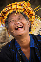 INLE LAKE, MYANMAR - CIRCA DECEMBER 2013: Happy burmese woman in the Taung Tho Market in Inle Lake, Myanmar