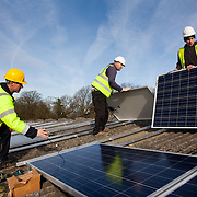 Leo Smith from Southern Solar and Andy Tyrrell and Jake Beautyman install solar panels on a barn roof on Grange farm, near Balcombe. The installation is part of an initiative by local residents in Balcombe to encourage more people to use renewable energy rather than energy based on carbon such as fracking. The initaitive is called Repowerbalcombe and is supported by the charity 10:10.