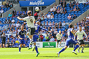 Matt Smith goes for a header for Fulham  during the Sky Bet Championship match between Cardiff City and Fulham at the Cardiff City Stadium, Cardiff, Wales on 8 August 2015. Photo by Shane Healey.