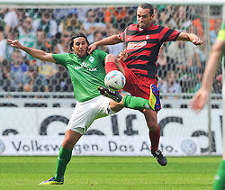 20.08.2011, Weser Stadion, Bremen, GER, 1.FBL, Werder Bremen vs SC Freiburg, im bild .Claudio Pizarro (Bremen #24) Oliver Barth (Freiburg #15)./ during the Match GER, 1.FBL, Werder Bremen vs SC Freiburg on 2011/08/20,  Weser Stadion, Bremen, Germany..EXPA Pictures © 2011, PhotoCredit: EXPA/ nph/  Kokenge       ****** out of GER / CRO  / BEL ******