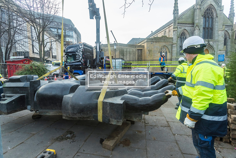 One of the three sculptures that make up The Manuscript of Monte Cassino by Eduardo Paolozzi has been removed from its site on Edinburgh's Picardy Place to allow works on the new St James quarter.<br /> <br /> Local residents have expressed concern that the sculpture won't return to the original site when the works have completed.<br /> <br /> The work was commissioned by entrepreneur, Sir Tom Farmer and remembers the bombing during WW2 of the Monte Cassino monastery - close to the artists family home.<br /> <br /> Pictured: The hand sculpture is lifted onto the truck that will take it to its new temporary location at nearby Hillside Place