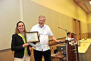 Bennett Award-  Jill McAllister, Minister, People's Church,  Kalamazoo, Michigan accepts the award for her church from Craig Roshaven.
