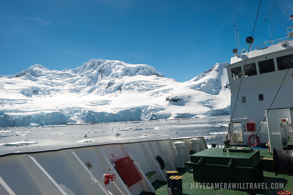 Mountain landscape in Antarctica, as seen from the bow of a ship.