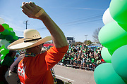 Todd McCoy throws beads to the crowd at the Dallas St. Patrick's Parade on Greenville Avenue, Saturday, March 16, 2013. (Cooper Neill/The Dallas Morning News)